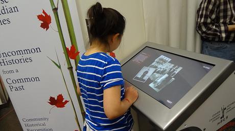 Girl reading at kiosk