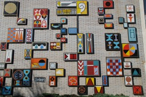 Image of a multi-coloured mosaic on a building wall (Brock Hall at UBC)