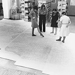 Library staff examining map