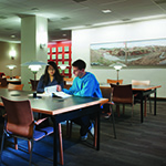 Students studying in Woodward Library