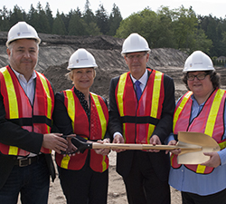 Four people at groundbreaking
