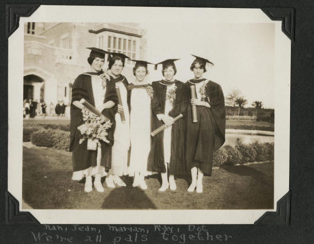 <em>Image of a group of women standing outside the old UBC library (now the Irving K. Barber Learning Centre) in graduation gowns. May 7, 1931.</em> From the Uno Langmann Family Collection of B.C. Photographs (UL_1046_0041).