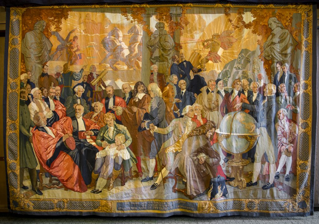 """The""""Masters of Science"""" tapestry was worked on in 1948."""
