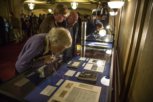 Guests exploring the exhibition at the Orpheum.