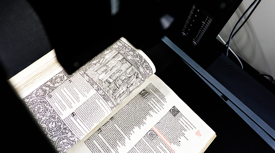 photo of the kelmscott press' works of geoffrey chaucer being digitized with a scanner camera